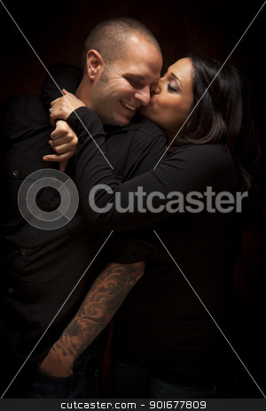 Happy Mixed Race Couple Flirting with Each Other stock photo, Happy Mixed Race Couple Flirting with Each Other Portrait Against A Black Background. by Andy Dean