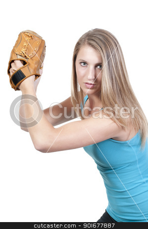 Woman Baseball Player stock photo, A beautiful woman baseball pitcher getting ready to throw a ball in a game by Robert Byron