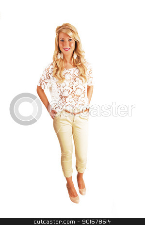 Slim girl standing. stock photo, A young pretty woman in a beautiful blouse and beige pants standing with her long curly blond hair for white background.  by Horst Petzold