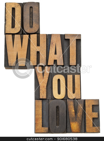do what you love in wood type stock photo, do what you love - motivation  concept - isolated text in vintage letterpress wood type by Marek Uliasz