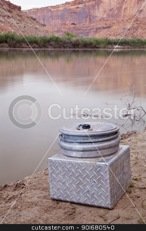 portable toilet on a shore of southwestern river stock photo, small metal portable toilet on a shore of Green River, equipment required on river trips in Canyonlands, Utah by Marek Uliasz