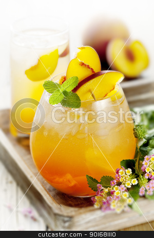 peach cocktail stock photo, refreshing  summer cocktail, made with peach by Liv Friis-Larsen