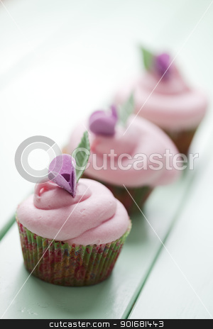 Pastel cupcakes stock photo, closeup of beautiful summer cupcakes with strawberry flavoured cream  by Liv Friis-Larsen