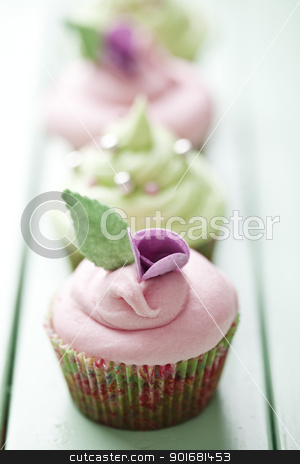 Pastel cupcakes stock photo, closeup of beautiful summer cupcake with strawberry flavoured cream  by Liv Friis-Larsen