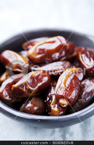 dried dates stock photo, handmade bowl with dried dates by Liv Friis-Larsen