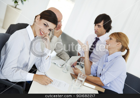 business meeting stock photo, two young business woman or office workers discussing paperwork by Liv Friis-Larsen