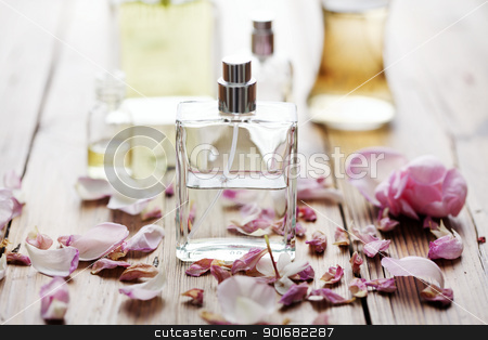 perfume stock photo, selection of perfume bottles surrounded by flower petals by Liv Friis-Larsen