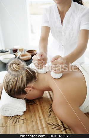 wellness stock photo, female ready for massage or other wellness treatment by Liv Friis-Larsen