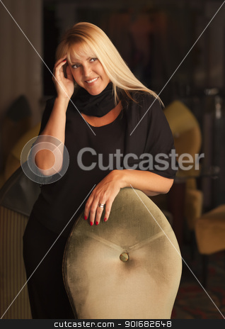 Beautiful Blonde Woman Standing Near Chair stock photo, Sensual Beautiful Blonde Woman Standing Near Chair. by Andy Dean