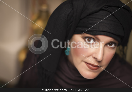Beautiful Islamic Woman Wearing Traditional Burqa or Niqab stock photo, Beautiful Smiling Islamic Woman Wearing Traditional Burqa or Niqab. by Andy Dean