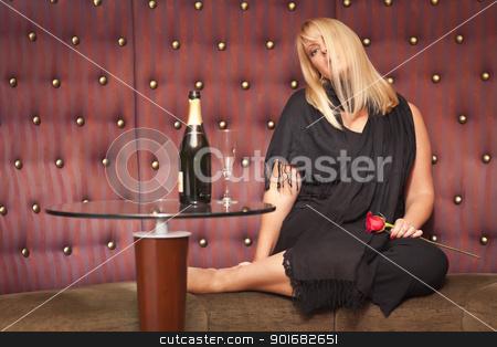 Sensual Blonde Woman Sitting Near Champagne and Rose stock photo, Sensual Beautiful Blonde Woman Sitting Near Champagne and Rose. by Andy Dean