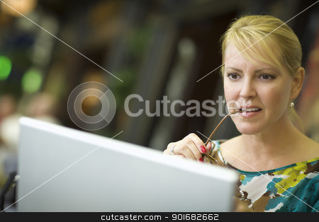 Beautiful Blonde Woman On Her Cell Phone and Laptop Computer in  stock photo, Beautiful Blonde Woman Using Her Laptop Computer in the City Lights. by Andy Dean