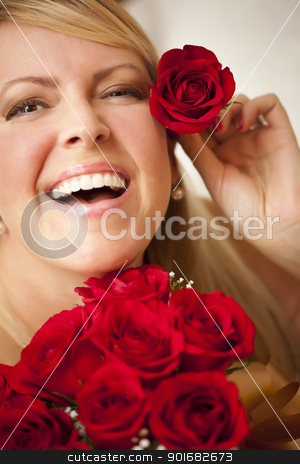 Woman with a Bunch of Red Roses. stock photo, Beautiful Woman with a Bunch of Red Roses and Places One Above Her Ear. by Andy Dean