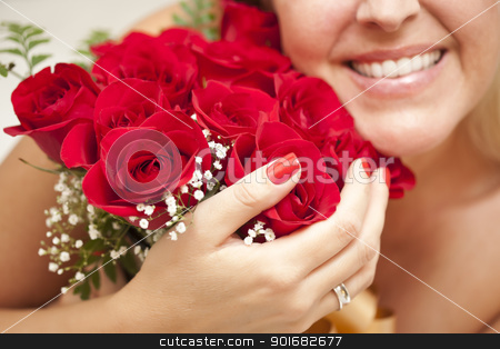 Smiling Woman Holding Bunch of Red Roses stock photo, Beautiful Smiling Woman with a Bunch of Red Roses. by Andy Dean