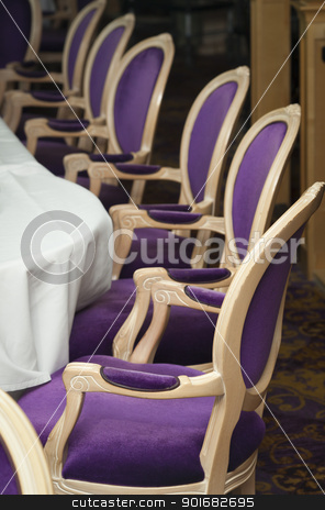 Luxurious Purple Chairs in Formal Dining Room  stock photo, Several Luxurious Purple Chairs Lined Up in a Formal Dining Room.  by Andy Dean