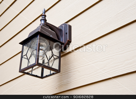 Porch light stock photo, Porch light on urban home by Jaime Pharr