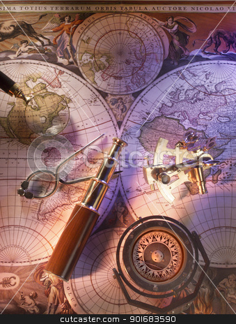 Old nautical world map stock photo, Old nautical map of the world with compass and brass telescope by Christian Delbert