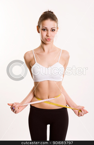Don't overdo it. stock photo, Slender young fitness brunette all tied up in measuring tape. by exvivo