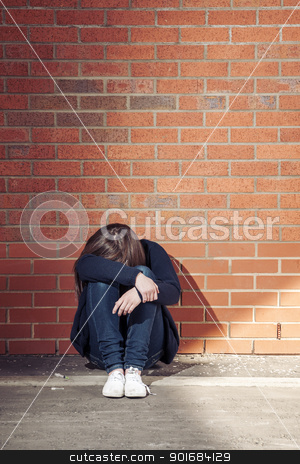 Addicted (first in the series) stock photo, Addicted, sad young woman sitting against the brick wall with syringe beside.  Vertical. by nowoka1na