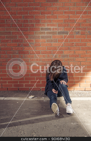 Addicted (second in the series) stock photo, Addicted, sad young woman sitting against the brick wall with syringe and cigarettes beside.  Vertical. by nowoka1na