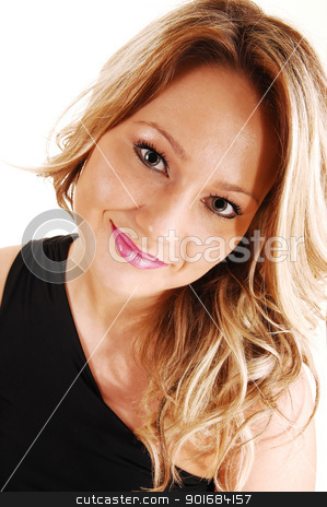 Portrait of pretty woman. stock photo, A closeup portrait of a beautiful mitt twenty woman with long blond hair, wearing a black dress, over white.  by Horst Petzold