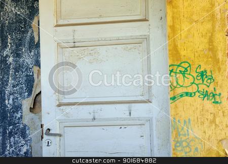 wooden door wallpaper shreds peeling wall stock photo, Wooden door, torn vintage wallpaper and peeling walls in abandoned interior. by sirylok