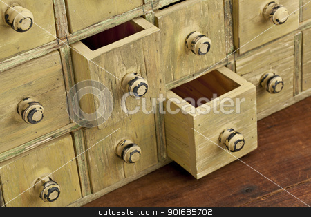 vintage apothecary drawer cabintet stock photo, drawers of primitive vintage grunge wood apothecary cabinet by Marek Uliasz
