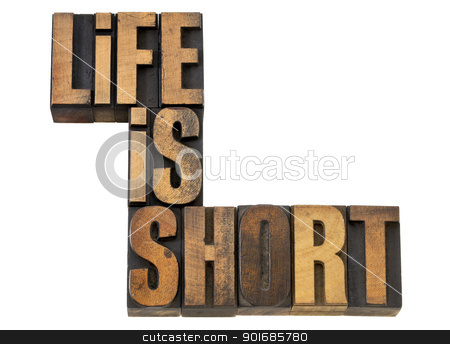 life is short phrase in wood type stock photo, life is short phrase wisdom reminder - isolated text in vintage letterpress wood type by Marek Uliasz