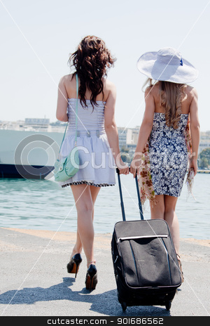 Portrait of a young and beautiful girl in the background of a large ocean liner stock photo, Portrait of two young and beautiful girls in the background of a large ocean liner by Artamonov Yury