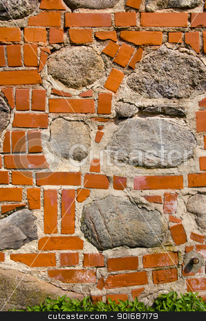 Big stones in red brick wall. Architecture closeup  stock photo, Big stones in red brick wall. Architecture closeup background details.  by sauletas