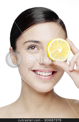 vitality stock photo, young smiling woman with a lemon slice in front of her eyes by Liv Friis-Larsen