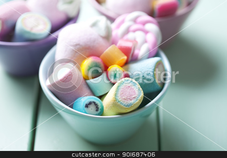 candy stock photo, bowl full of colorful pastel marchmellows and rock candy by Liv Friis-Larsen