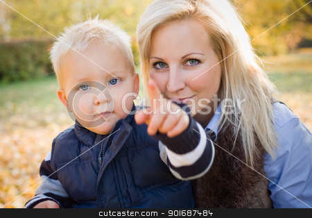 Cute kid and pretty mom outdoors at fall. stock photo, Portrait of cute kid and pretty mom having fun outdoors at fall. by exvivo