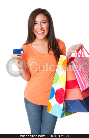 Credit card shopping stock photo, Beautiful Happy smiling young woman on shopping spree with credit card lastic money carrying colorful bags with merchandise presents, isolated. by Paul Hakimata