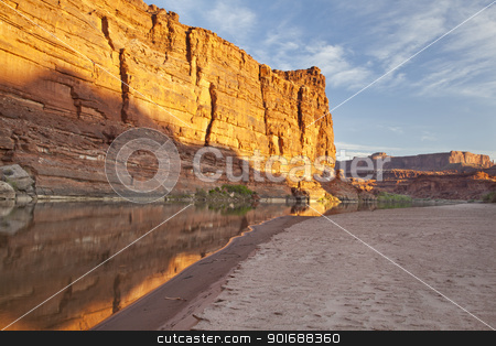 Colorado River in Canyonlands stock photo, Colorado River at sunrise in Canyonlands National Park with rock cliffs and sandbar by Marek Uliasz