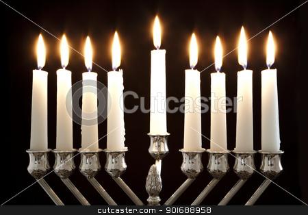 Hanukkah Menorah / Hanukkah Candles stock photo, Silver Hanukkah candles all candle lite on the traditional Hanukkah menorah by Dmitry Pistrov