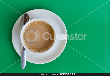 Coffee cup on green background stock photo, Coffee cup on green background by pattarastock