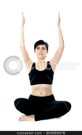 Portrait of beautiful young woman doing yoga exercise stock photo, Portrait of beautiful young woman doing yoga exercise. Arms raised by Ishay Botbol