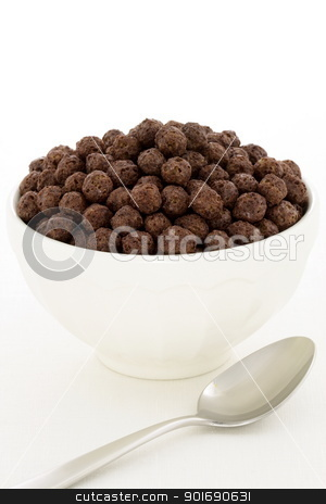 Delicious healthy chocolate kids cereal stock photo, delicious and nutritious whole wheat and oats chocolate cereal, flavorful, funny and healthy addition to kids breakfast by Raul Taborda