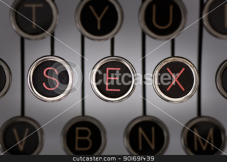 Vintage Sex stock photo, Close up of old typewriter keyboard with scratched chrome keys with black centers and white letters. Lighting and focus are centered on for keys spelling out