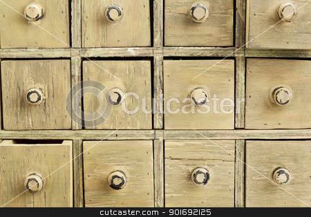 primitive apothecary drawer cabinet stock photo, drawers of primitive vintage grunge wood apothecary cabinet by Marek Uliasz