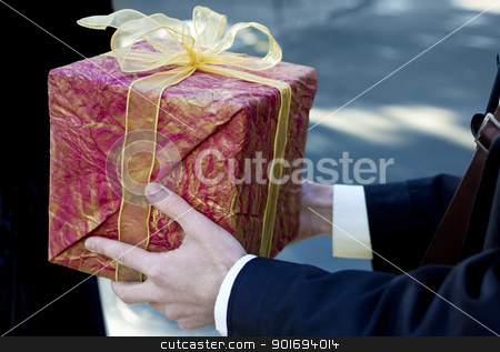 Man present red gift box stock photo, Man present red gift box with ribbon bow, side view by sermax55
