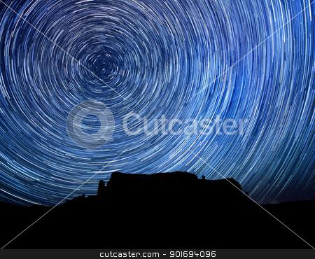 Long Exposure Star Trail Image at Night stock photo, Monument Valley Long Exposure Star Trail Image by Katrina Brown