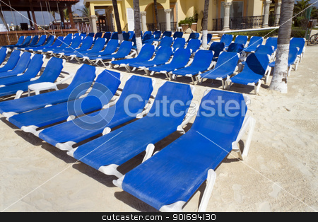 Rows of Blue Chairs stock photo, Rows of blue several lounge chairs on the beach by Kevin Tietz