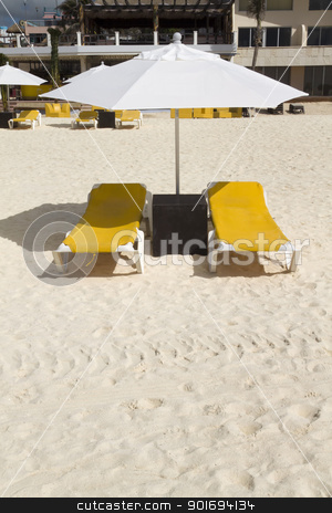 Lounge Chairs with Umbrella stock photo, A pair of beach lounge chairs with umbrella by Kevin Tietz