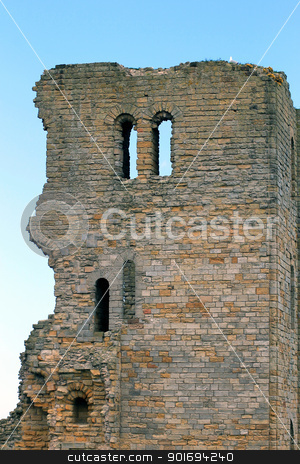 Scarborough castle keep stock photo, Scenic view of ruins of Scarborough Castle with blue sky and cloudscape background, North Yorkshire, England. by Martin Crowdy