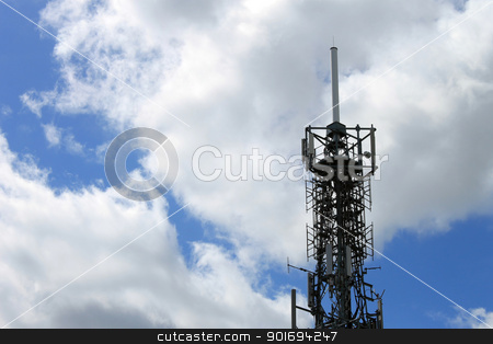 Telecommunications mast or tower stock photo, Modern telecommunications mast or tower with blue sky and cloudscape background. by Martin Crowdy