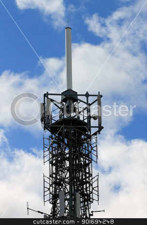 Telecommucations mast stock photo, Modern telecommunications mast or tower with blue sky and cloudscape background. by Martin Crowdy