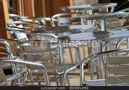 Vacant metal chairs and tables stock photo, Vacant metal chairs and tables on outdoor eating area in cafe or restaurant. by Martin Crowdy