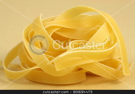 raw fettuccine  stock photo, beautiful fresh and raw fettuccine on yellow fine kitchen linen  shallow DOF   by Raul Taborda
